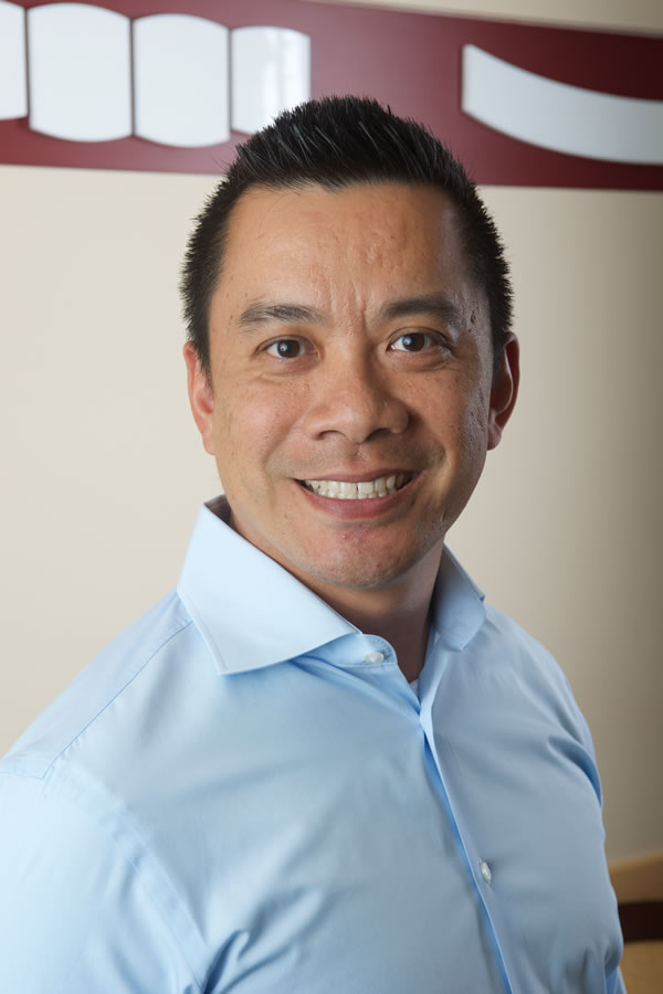 Raymond Liu, DDS who practices at his dental office in Edmonds, WA.