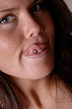 A woman with an oral piercing in her tongue.